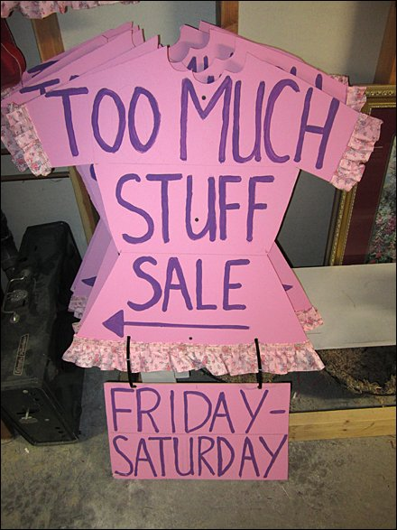 Too Much Stuff Consignment Sale Sign Fixtures Close Up